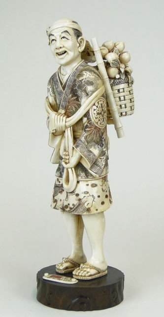6: 20C ORIENTAL CARVED FIGURE OF A MAN CARRYING BASKET