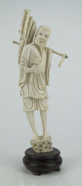 13: LARGE ANTIQUE CARVED IVORY CHINESE FARMER