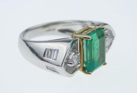 23: PLATINUM EMERALD & DIAMOND RING