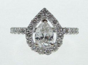 65: 18KT WHITE GOLD & PEAR SHAPED DIAMOND RING