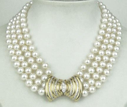 14: 18KT YELLOW GOLD FOUR STRAND PEARL DIAMOND NECKLACE