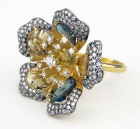 411: 18KT YELLOW GOLD DIAMOND AND DIAMOND SLIVERS FLOWE