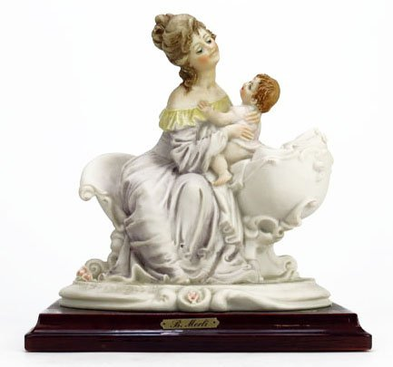 B. MERLI FIGURINE OF MOTHER WITH BABY