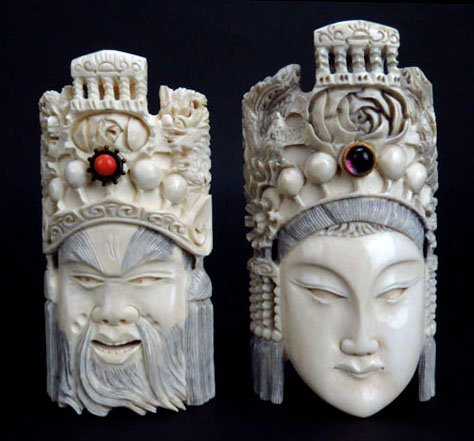 PAIR OF ANTIQUE CHINESE IVORY MASKS