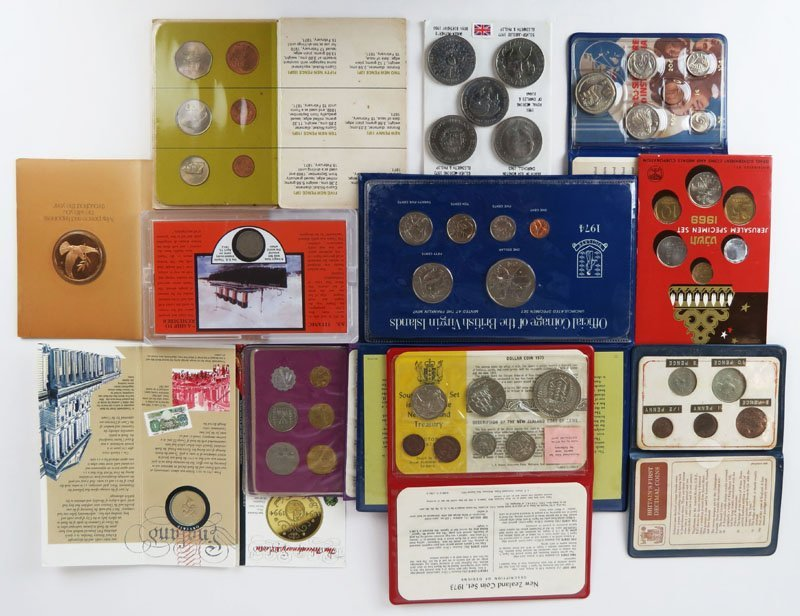 Eleven (11) Packaged Foreign Coin Sets. Shipping $28.00