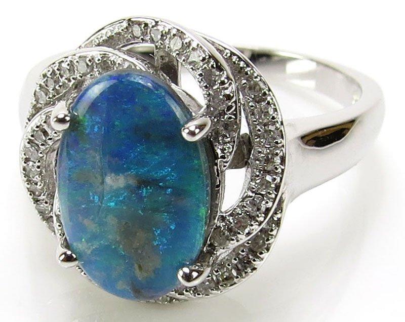 14 Karat White Gold, Diamond and Opal Lady's Ring.