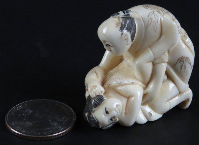 Japanese Carved Ivory Erotic Couple Netsuke. Signed.