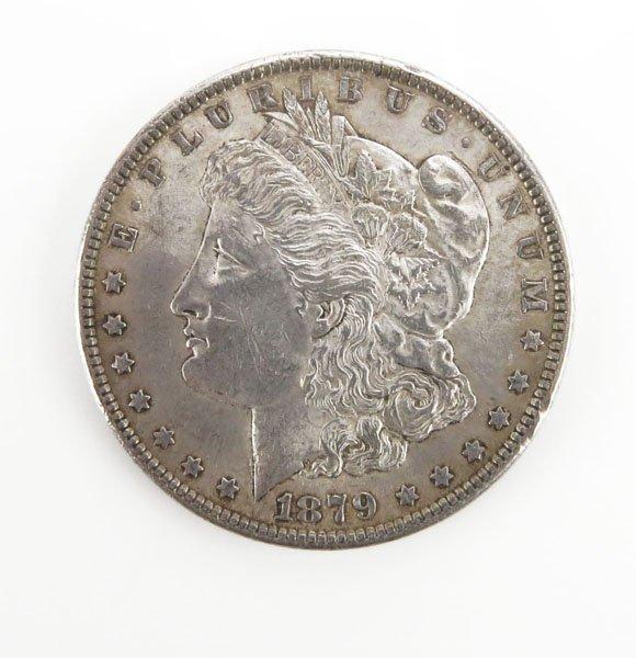 1879 U.S. Morgan Silver Dollar. Tarnished or else Good