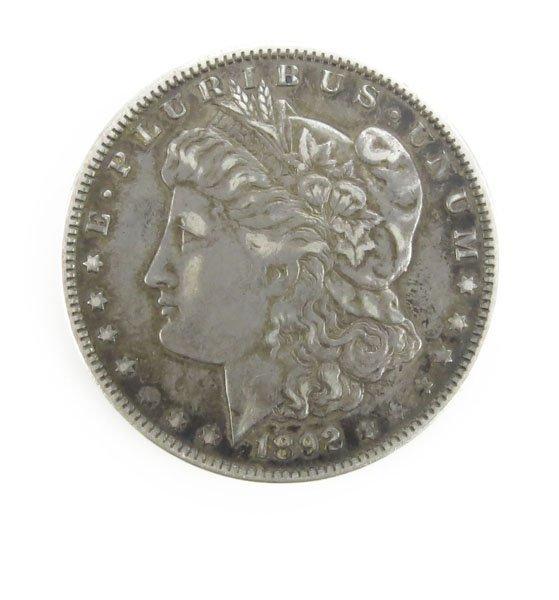 1892 U.S. Morgan Silver Dollar. Tarnished or else Good