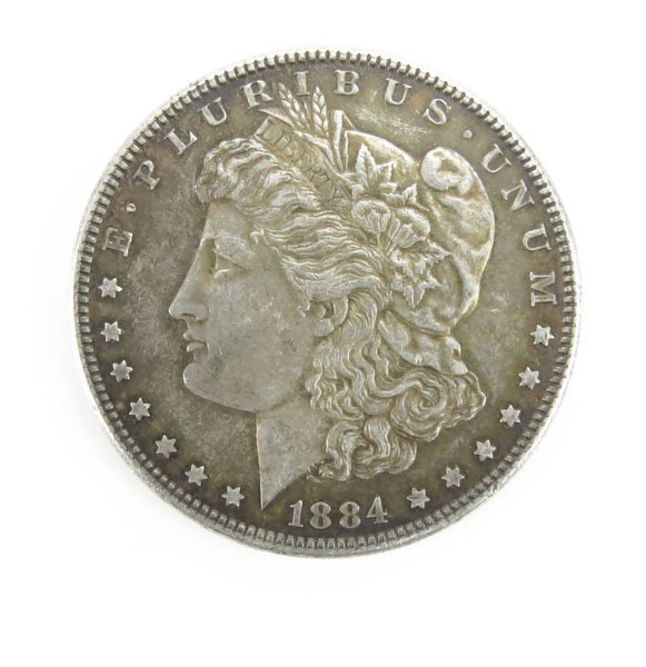 1884 U.S. Morgan Silver Dollar. Tarnished or else Good
