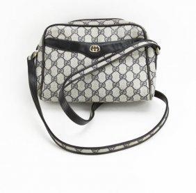 Vintage Designer Monogrammed Handbag. Marked Gucci.