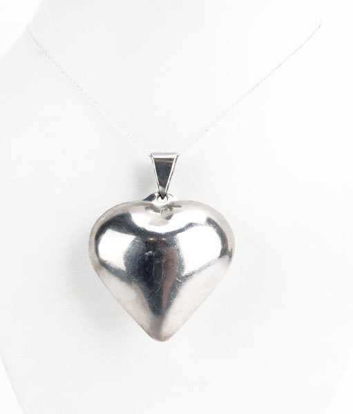 Sterling Silver Necklace with Heart Shaped Pendant.