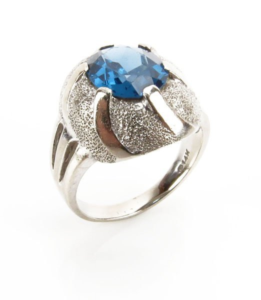 14 Karat White Gold and Blue Topaz Ring, Size 5-3/4. Si
