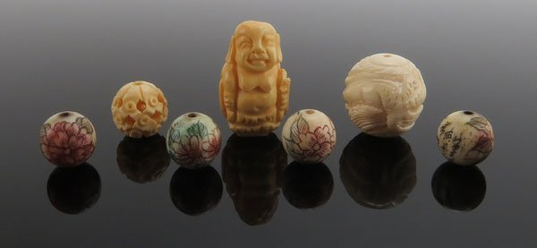 (7) Chinese Carved Ivory Beads. Normal Wear. This item