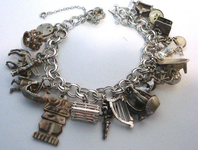 105: Sterling Charm Bracelet w/22 Charms