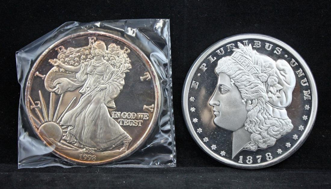 Two Paperweights (One Morgan; One Walking Liberty)