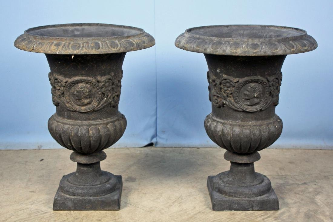 Two Grecian Style Cast Iron Flower Urns