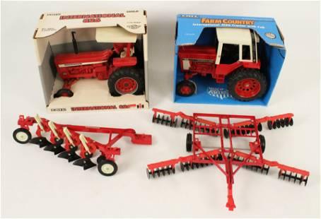 Two International Die Cast Tractors & Equipment