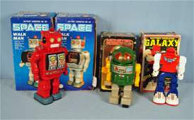 4 Battery Operated Tin  Plastic Robot Toys