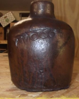 14: Small pottery Amoco jug
