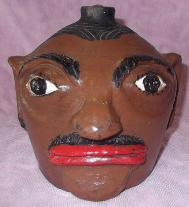 11: Arie Meaders glazed & painted face jug