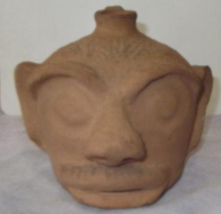 15: Arie Meaders unglazed face jug