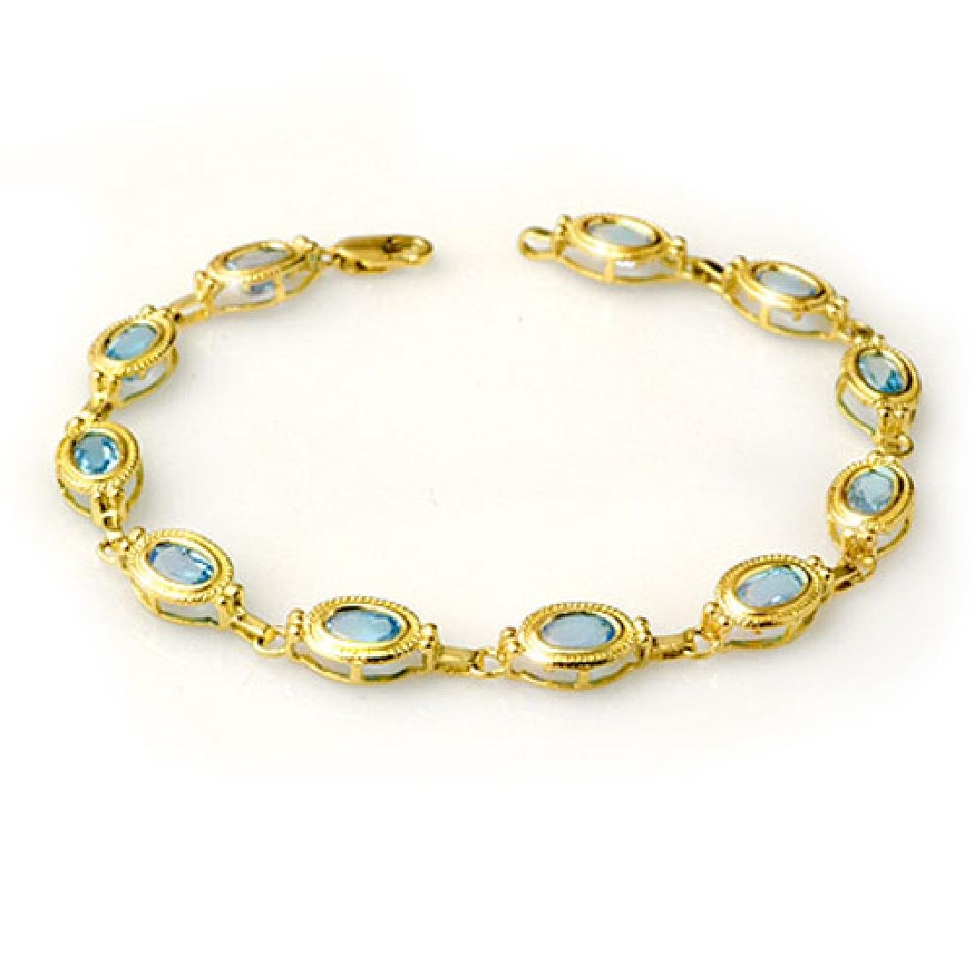 6.50 CTW Blue Topaz Bracelet 10K Yellow Gold