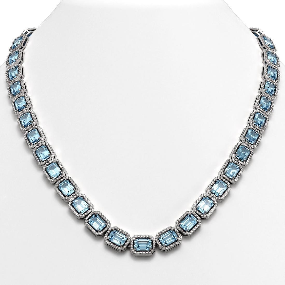 52.89 CTW Sky Topaz & Diamond Halo Necklace 10K White