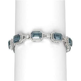 44.52 ctw Blue Topaz & Diamond Bracelet 18K White Gold