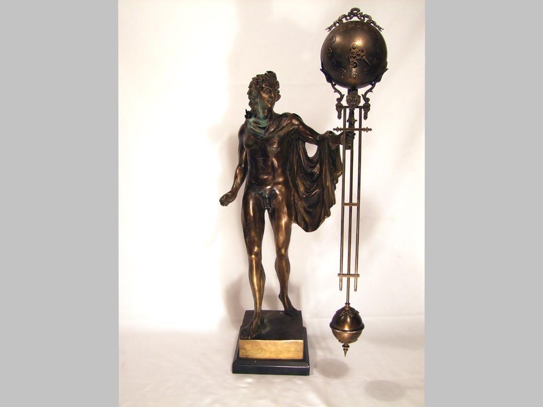23: Bronze Male Swinging Arm Clock