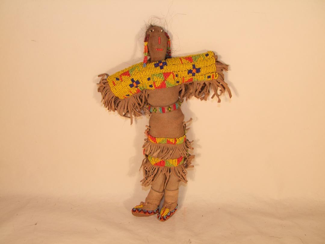 "117: 12 1/2"" Navaho  Indian Doll with beadwork and frin"