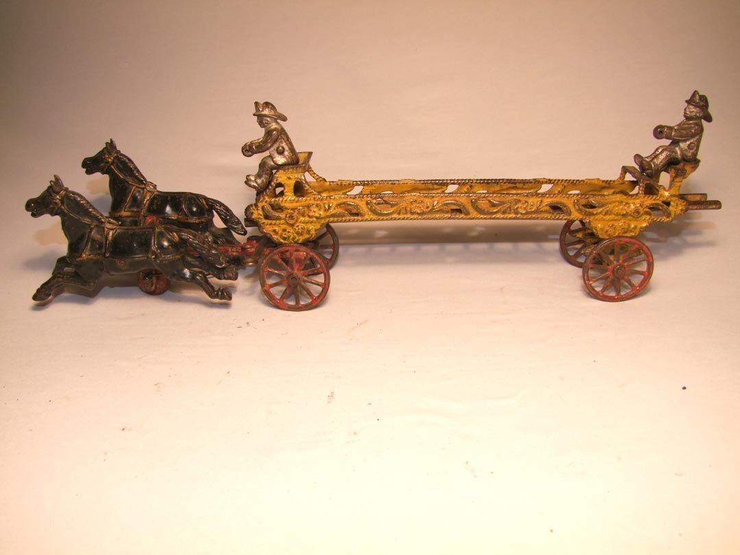 8: Ives Cast Iron Ladder Wagon