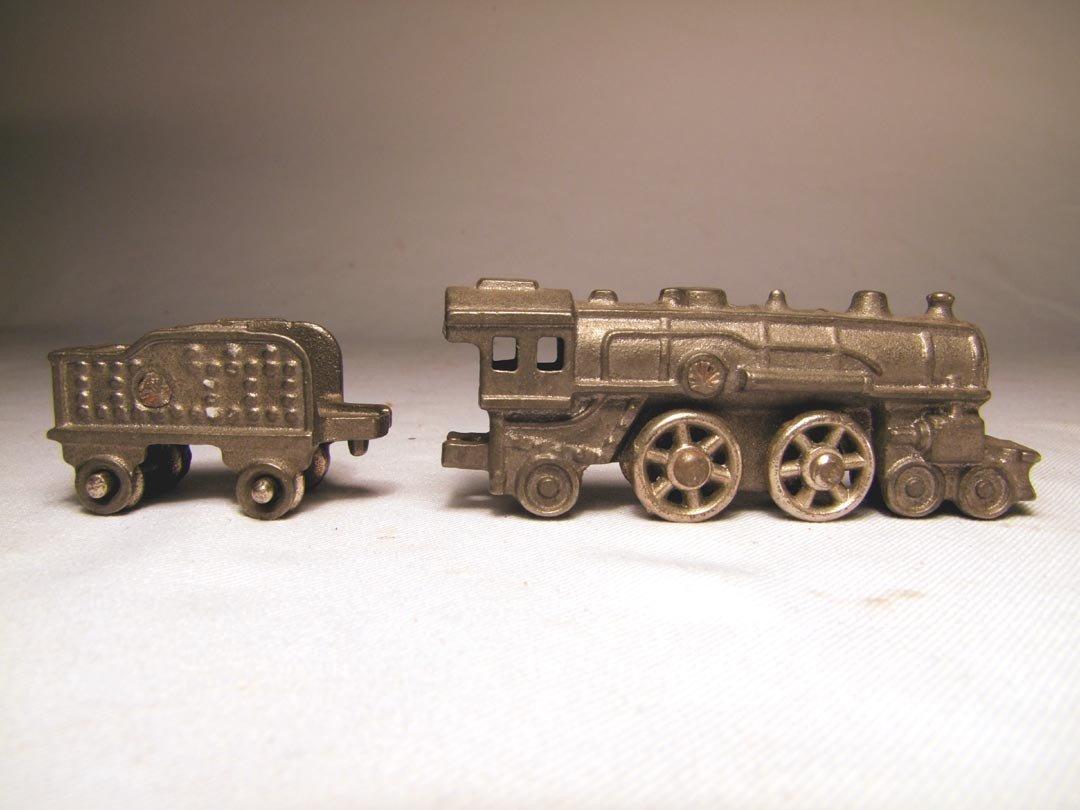 220: Cast Iron Engine And Coal Car