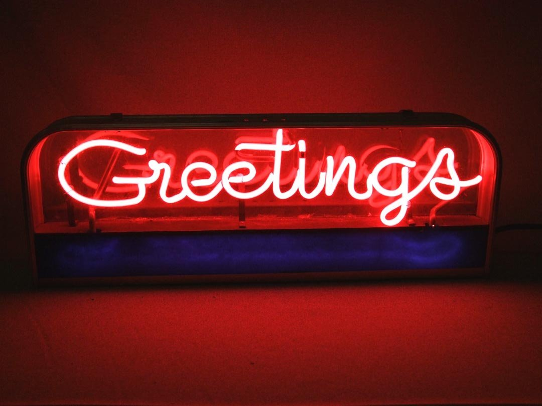 "Neon ""GREETINGS"""