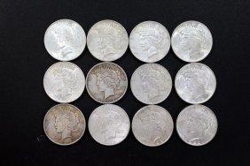Twelve 1922 Peace Dollars