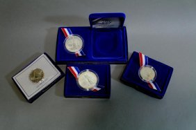 Four Cased Coins