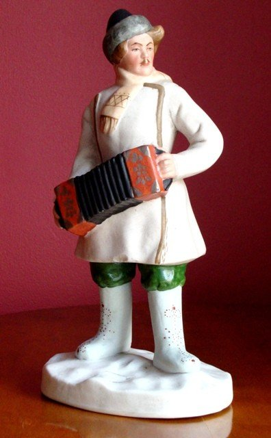 1: A Soviet Porcelain Figure of an Accordion Player