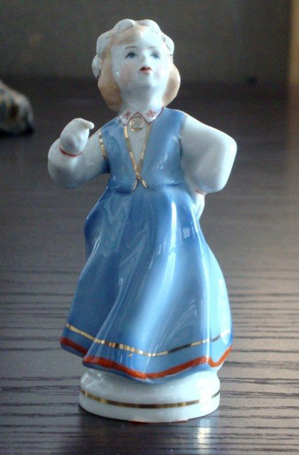7: A Soviet Porcelain Figure of Girl with floral wreath