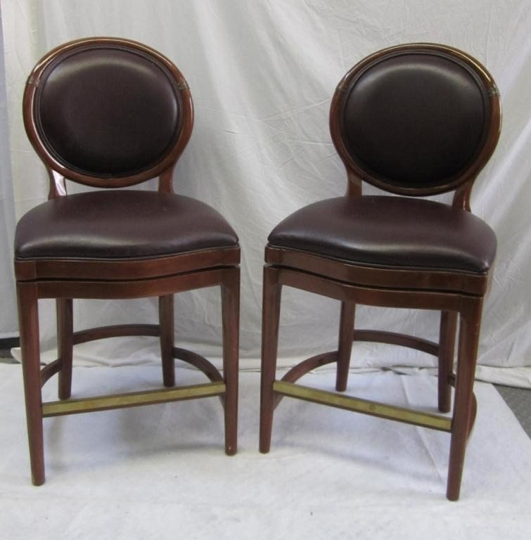 226: Pair Swivel Leather Bar Stools.