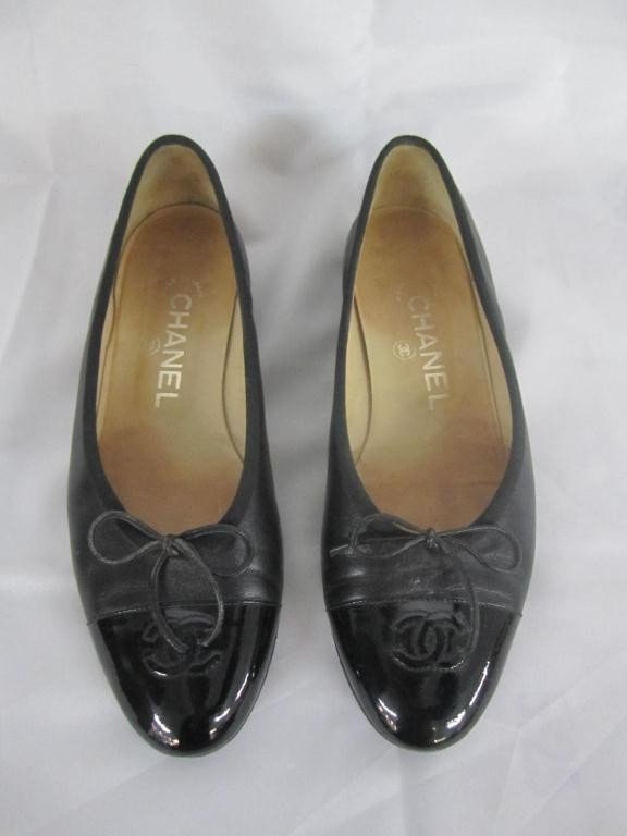 11: Pair Chanel Black Leather Slippers