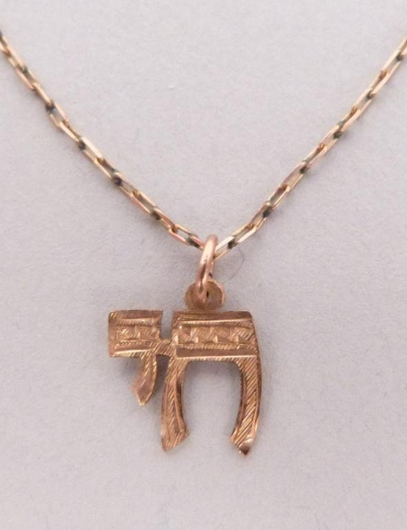 "7: 14K Gold Chai"" on Metal Chain"""