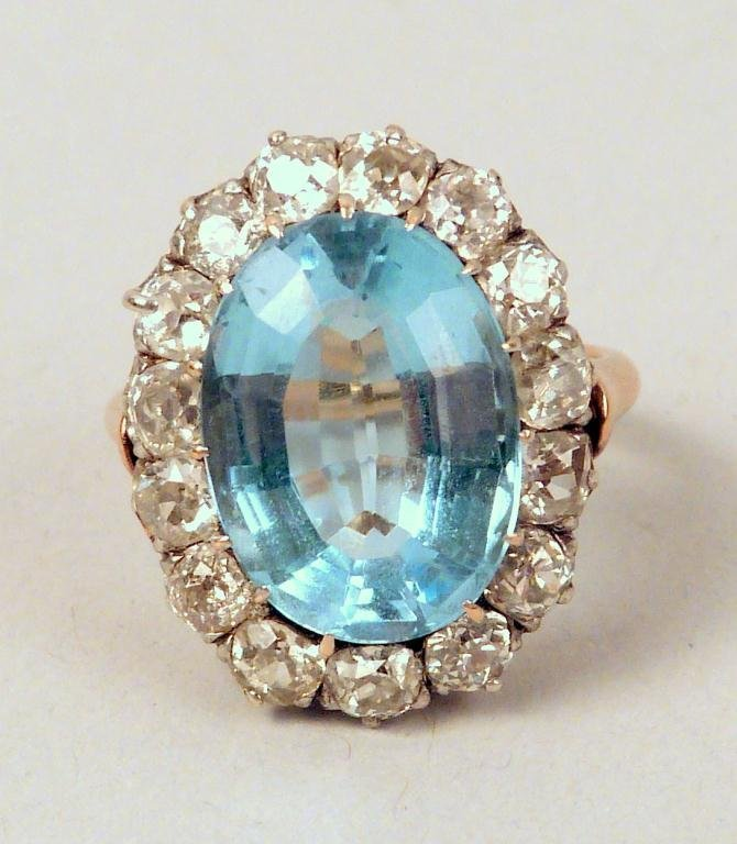 18: Gold, Blue Aquamarine and Diamond Ring