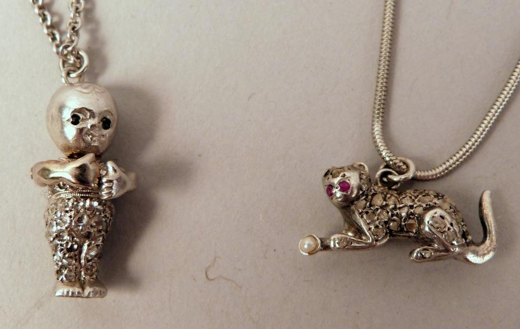 21: 2 Platinum Necklaces with Interesting Charms