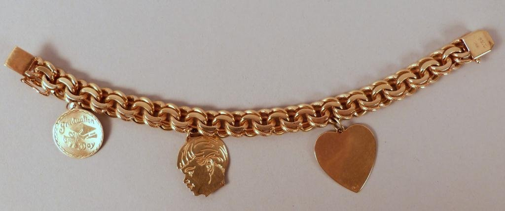 22: 14K Gold Charm Bracelet and 14K Charms