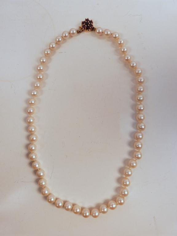 11: Pearl Necklace