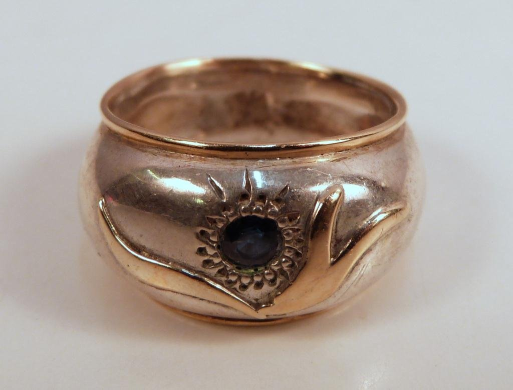 16: Unmarked Gold and Silver Mounted Ring