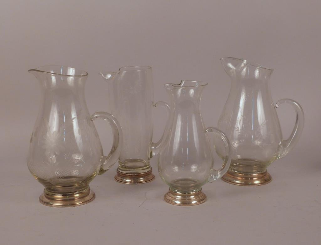 Four Sterling Silver Mounted Glass Pitchers