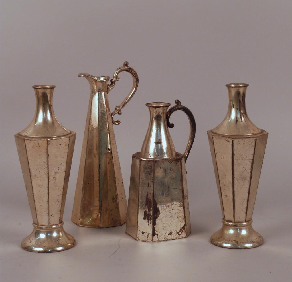 Four Geometric Quadruple Plated Silver Pitchers