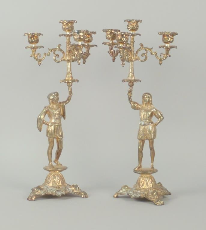 Pair of Figurative White Metal Candelabras