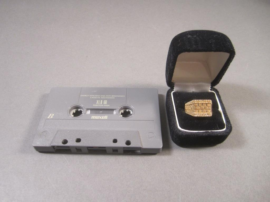 18K Gold Ring and a Cassette Tape